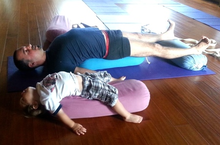 This father and son team are practicing Supported Setu Bandasana together at the New Iyengar Yoga Center of Ojai. The Ojai valley - considered one of the most beautiful valleys in the world, is situated between Los Angeles and Santa Barbara.